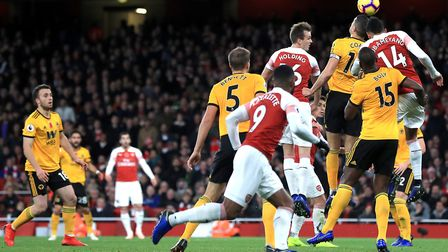 Arsenal's Henrikh Mkhitaryan (third left, background) scores his side's first goal of the game durin