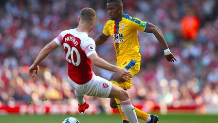 Arsenal's Shkodran Mustafi (left) and Crystal Palace's Wilfried Zaha battle for the ball during the