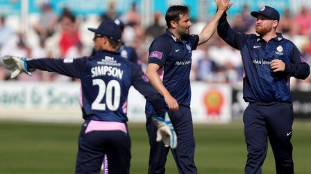 Tim Murtagh (centre) of Middlesex celebrates taking the wicket of Sir Alastair Cook with Paul Sterli