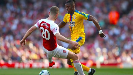 Arsenal's Shkodran Mustafi (left) and Crystal Palace's Wilfried Zaha battle for the ball (pic Bradle