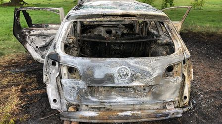 Shell of a burnt out car in Gladstone Park