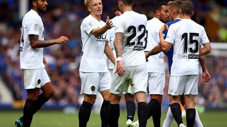 Valencia's Daniel Wass celebrates scoring his side's third goal of the game during the pre-season fr
