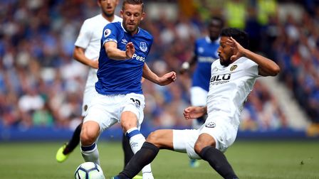 Everton's Gylfi Sigurdsson and Valencia's Ezequiel Garay (right) battle for the ball during the pre-