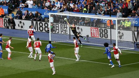 Arsenal's Bernd Leno saves from Leicester City's Wilfred Ndidi during the Premier League match at th