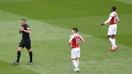 Referee Michael Oliver sends off Arsenal's Ainsley Maitland-Niles during the Premier League match at