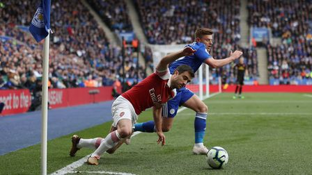 Arsenal's Sokratis Papastathopoulos and Leicester City's Harvey Barnes during the Premier League mat
