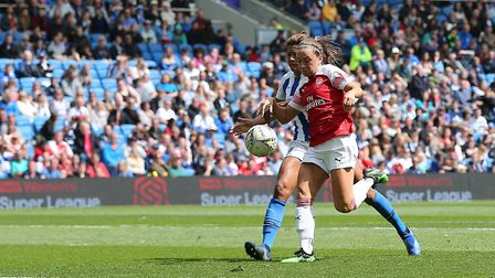 Arsenal's Katie McCabe scores her sides second goal of the match during the FA Women's Super League