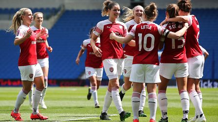 Arsenal's Katie McCabe celebrates scoring her sides second goal of the match with team mates during