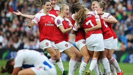 Arsenal's Beth Mead celebrates scoring her sides third goal of the match with team mates during the