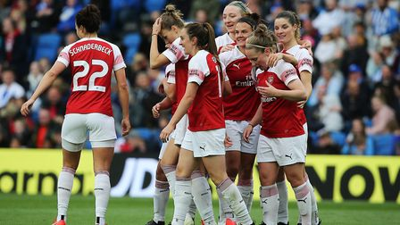 Arsenal's Danielle van de Donk celebrates scoring her sides fourth goal of the match with team-mates