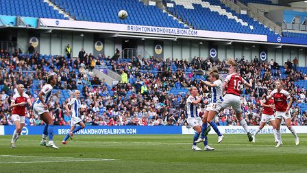 Arsenal's Louise Quinn heads towards goal during the FA Women's Super League match at the AMEX Stadi