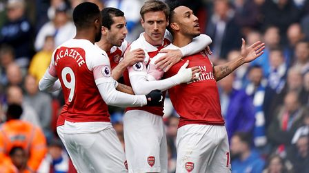Arsenal's Pierre-Emerick Aubameyang (right) celebrates scoring his side's first goal of the game fro
