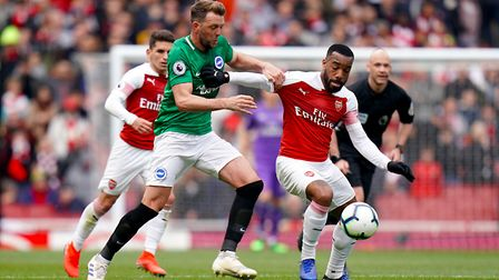 Brighton & Hove Albion's Dale Stephens (left) and Arsenal's Alexandre Lacazette battle for the ball