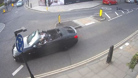 The driver of the BMW which hit Josh Dey can be seen talking to a friend moments after smashing into
