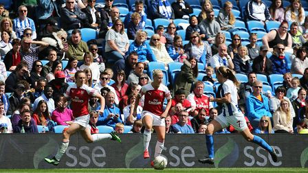 Arsenal's Beth Mead holds the ball up as Arsenal's Lisa Evans makes a run during the FA Women's Supe