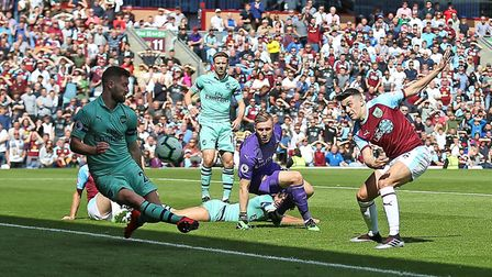 Burnley's Matthew Lowton (right) has a shot blocked by Arsenal's Shkodran Mustafi (left) during the