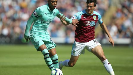 Burnley's Jack Cork (right) and Arsenal's Joe Willock battle for the ball during the Premier League
