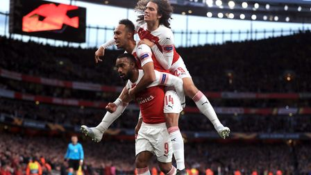 Arsenal's Alexandre Lacazette (left) celebrates scoring his side's second goal of the game with Pier