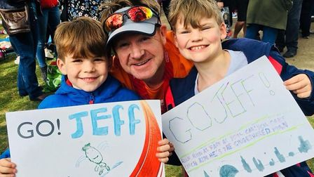 Jeff Strachan with his children after running the marathon in aid of Brent Centre for Young People.
