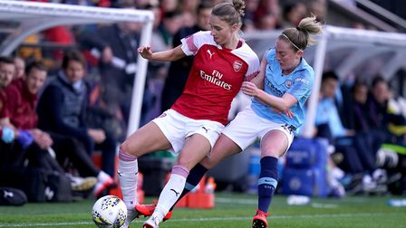 Arsenal's Vivianne Miedema, (left) battles for possession of the ball with Manchester City's Keira W