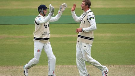 Middlesex's Ollie Rayner (right) and wicketkeeper John Simpson (left) celebrate (pic John Walton/PA)