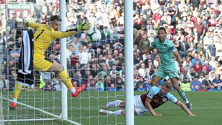 Arsenal's Pierre-Emerick Aubameyang (right) scores his side's second goal of the game during the Pre