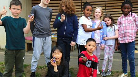 Children from the Three Corners Adventure Playground with solar powered toy cars. Picture: Islington