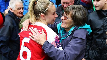 Arsenal's Leah Williamson celebrates with family after winning the FA Women's Super League at full t