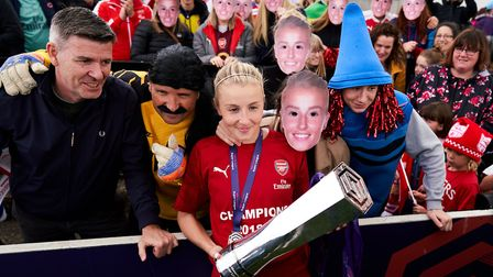 Arsenal's Leah Williamson celebrates with the trophy during the FA Women's Super League match at Mea