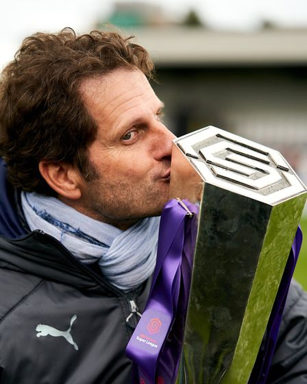 Arsenal women's manager Joe Montemurro celebrates with the trophy during the FA Women's Super League