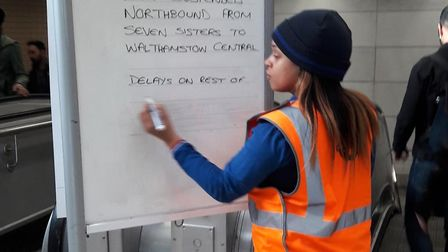 A board announcing delays at Highbury and Islington.