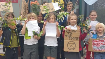 Exctinction Rebellion kids ask Jeremy Corbyn to help them fight climate change. Picture: Exctinction