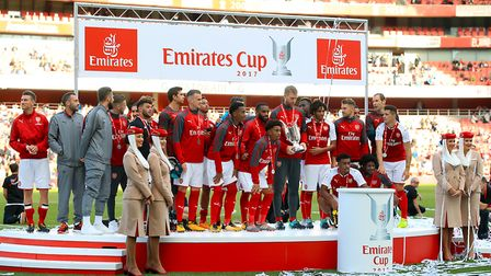 Arsenal players pose with the trophy after winning the Emirates Cup at the Emirates Stadium, London.