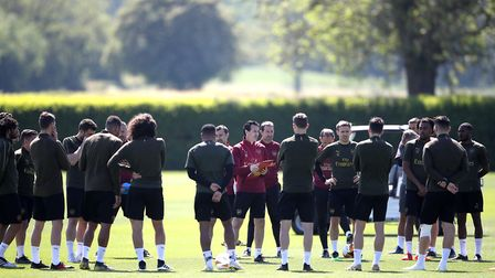 Arsenal manager Unai Emery (centre) during the training session at London Colney, Hertfordshire. Pic