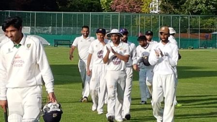 Crouch End players celebrate as they leave the field (pic: Crouch End CC).