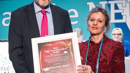 Madeleine Holt recieving her award at the National Education Union conference. Picture: Supplied