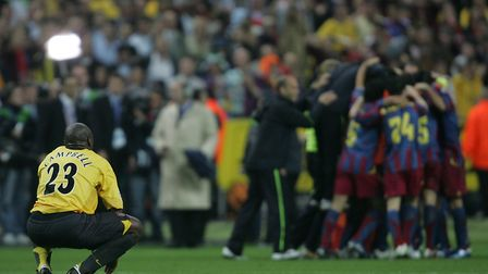 Arsenal's Sol Campbell looks on as Barcelona's players celebrate victory. Picture: David Davies/PA A