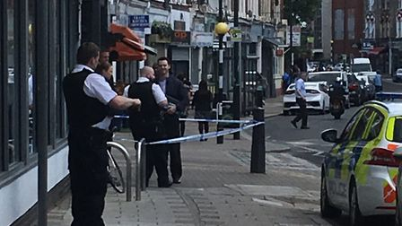 Police outside Tesco Express in Willesden Lane which was robbed by armed men. Picture: Gerry Agar
