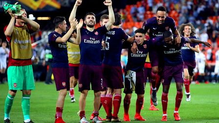 Arsenal players celebrate on the pitch at the end of the UEFA Europa League, Semi Final, Second Leg