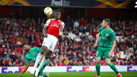 Arsenal's Danny Welbeck scores his side's second goal of the game. Picture: PA