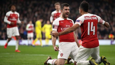 Arsenal's Sokratis Papastathopoulos (left) celebrates scoring his side's third goal of the game with