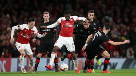 Arsenal's Ainsley Maitland-Niles (centre) under pressure during the Europa League match at the Emira
