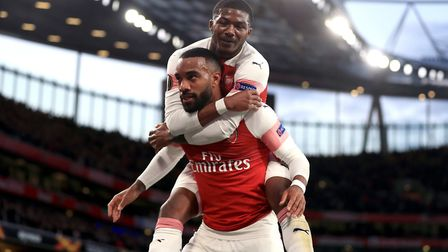 Arsenal's Alexandre Lacazette (left) celebrates scoring his side's second goal of the game with Ains