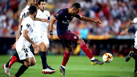 Arsenal's Pierre-Emerick Aubameyang (centre) scores his side's first goal of the game during the UEF