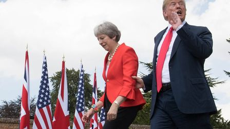 US president Donald Trump walks with prime minister Theresa May prior to a joint press conference at