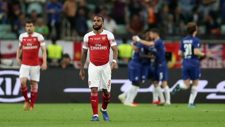 Arsenal's Alexandre Lacazette looks dejected after Chelsea's Olivier Giroud scores his side's first