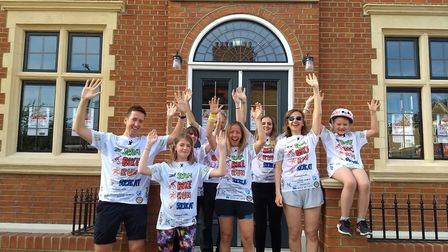 One of the Kensal Rise Triathlon teams outside the Kensal Rise Library which they are fundraising fo