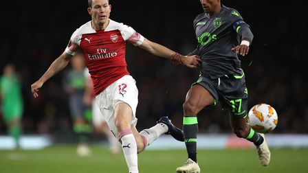 Arsenal's Stephan Lichtsteiner (left) and Sporting Lisbon's Luis Nani battle for the ball during the