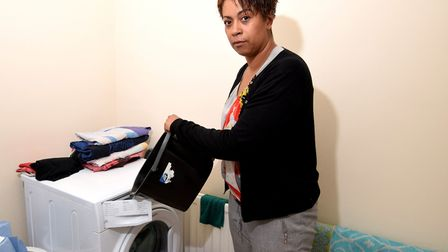 Samantha Trent. Fills her washing machine with a bucket because the water pressure is not sufficient