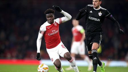 Arsenal's Bukayo Saka (left) and Qarabag's Miguel Michel battle for the ball during the UEFA Europa